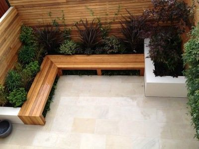 Underplanted bench with timber wall backdrop
