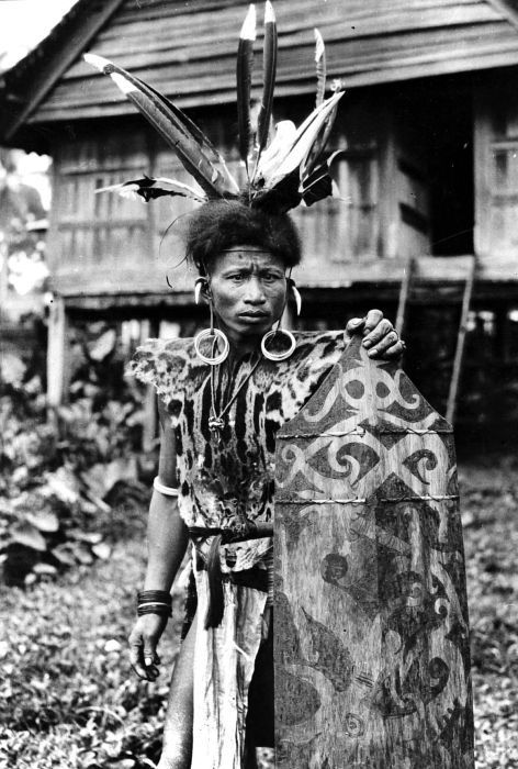 Indonesia ~ Borneo | Dayak from Kutai in war dress.  ca. 1948 or earlier | Photographer unknown
