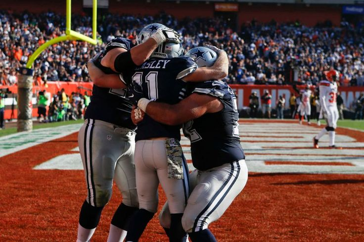 Cowboys vs. Browns:  35-10, Cowboys  -  November 6, 2016  -   Dallas Cowboys wide receiver Cole Beasley (11) celebrates his touchdown with guard Zack Martin, left, and center Travis Frederick, right, in the  first half of an NFL football game, Sunday, Nov. 6, 2016, in Cleveland. (Credit: AP / Ron Schwane)