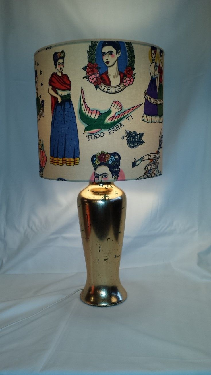 There's always a Frida. This lamp shade and base is so cool. Frida Kahlo shade measures 30cms in diameter x 28cms high,gold gilded  base 42 cms high. Love it.
