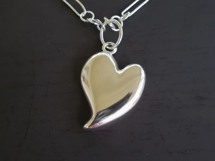 A Happy Heart is all you need - this one comes with a hand made silver necklace
