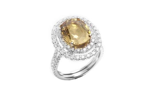 Lluis - Zafiro amarillo en oro blanco de 18K con brillantes.