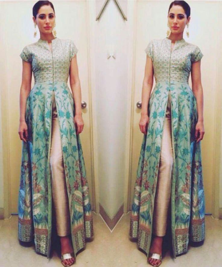 Nargis Fakhri wearing Anita Dongre. long center slit top with fitted pants #floral