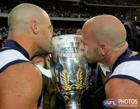 Josh Hunt (L) and Paul Chapman of Geelong kiss the cup after winning--- the AFL 2011 Toyota Grand Final match between the Collingwood Magpies and the Geelong Cats at the MCG, Melbourne.