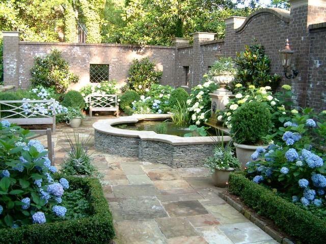 Fountain blue hydrangea and boxwood garden backyard for Beautiful courtyard gardens