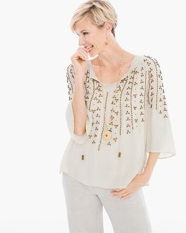 """Just call it boho-brilliance. Gorgeous beadwork cascades down this relaxed peasant top with a beaded tie detail at the neckline.    3/4-sleeves.   Regular length: 27"""".   Petite length: 26.5.""""   Rayon.   Hand wash. Imported."""