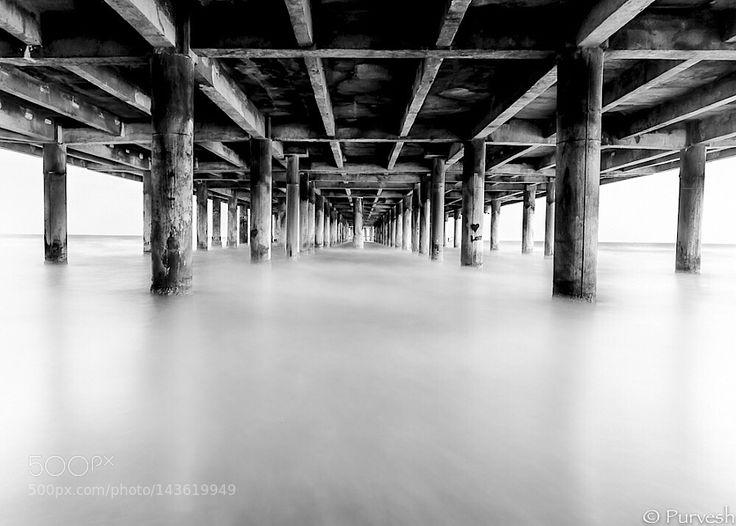 A long exposure taken under the pier in Galveston TX by Purvesh261
