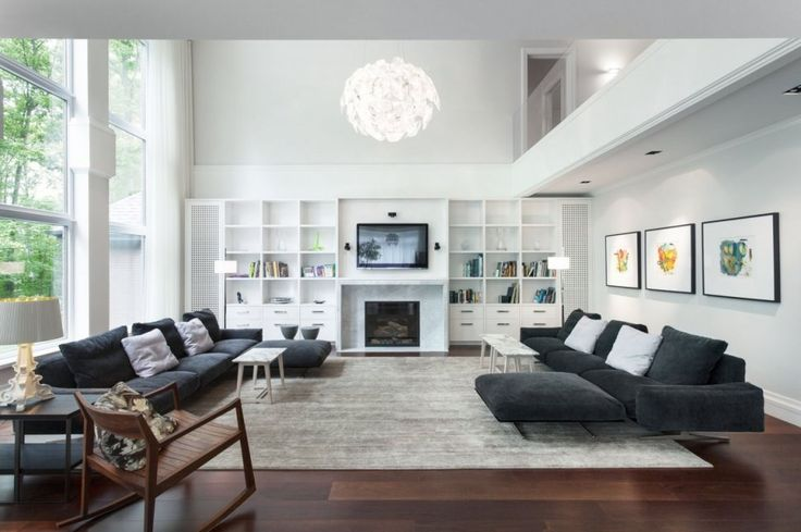 Interior:Luxury Scandinavian Interior Design Living Room With Pendant Lighting Feat Flat Screen Tv And Fireplace Bookshelf Floor Standing Lamps And Black Sofa Set Table Chair Table Lamps Rugs Laminate Wood Flooring Living Room? Think about the Scandinavian Interior Design Living Room