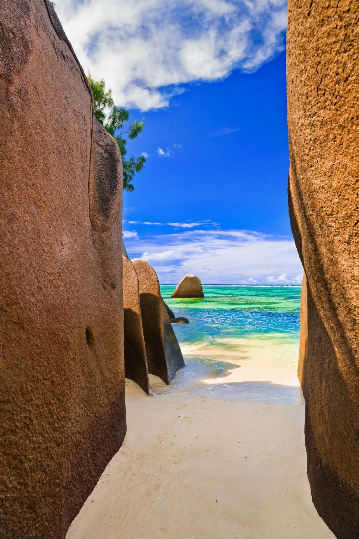 Standing between the rocks on Anse Source d'Argent Beach in the Seychelles. #Seychelles