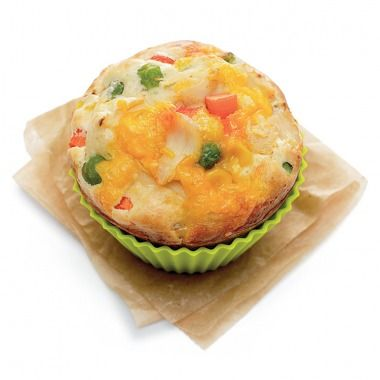 Prepare boxed pancake mix as directed. Place thawed frozen veggies (carrots, peas, corn), shredded cheddar cheese, and shredded rotisserie chicken in the wells of a muffin pan. Fill each well 3/4 full with pancake batter. Bake at 375°F for 25 to 30 minutes, or until a knife inserted in the center comes out clean.