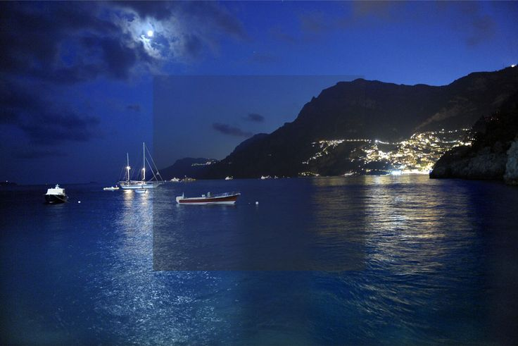 Positano bay at night as seen from the hotel's beach