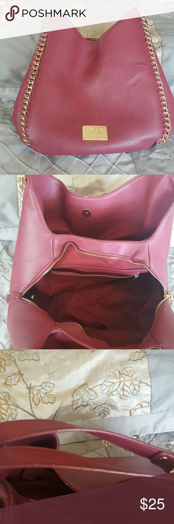 Bebe purse Burgundy Bebe purse.  Great purse.   Has some cracks on straps and inside one of the lips of the bag.   Clean.   Only used for about 1 month bebe Bags Shoulder Bags