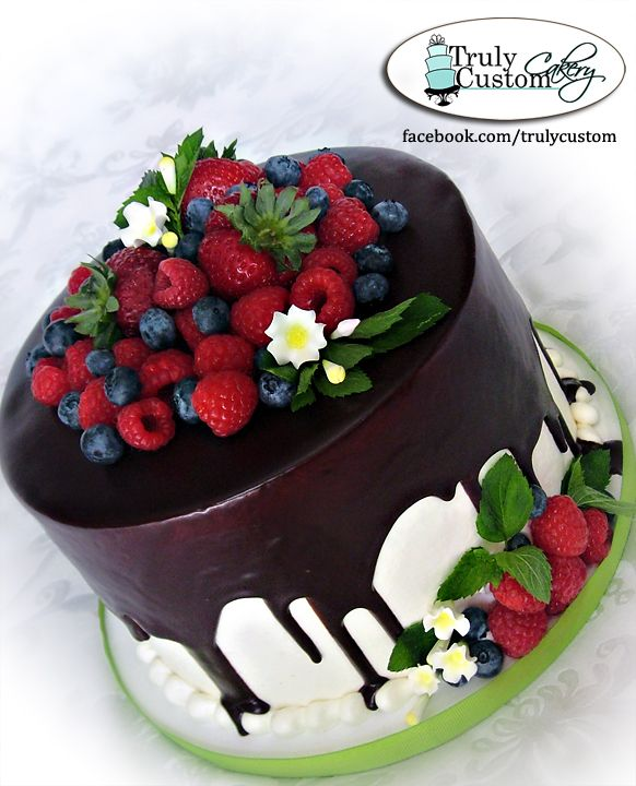 Gnache and Fresh Fruit - Sometimes you gotta make a cake and NOT send it home with a customer! I made this for my Mother-in-law's 70th Birthday. Double Dark Chocolate Cake, Raspberry Swirl Cheesecake Filling, Buttercream Icing, Poured Chocolate Gnache, and Fresh Strawberries, Blueberries, and Raspberries. Garnished with some fresh mint and a few gumpaste flowers. I wish we had smellavision. This whole cake smells like a fresh chocolate covered strawberry. MMMMMMM Yummy!
