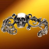 """$50. """"This Dead Man's Cuff is a magnificent pirate bracelet made of fine pewter. The ornate filigree design is centered with a foreboding skull. Hand made in England. Measures 7"""" around."""""""