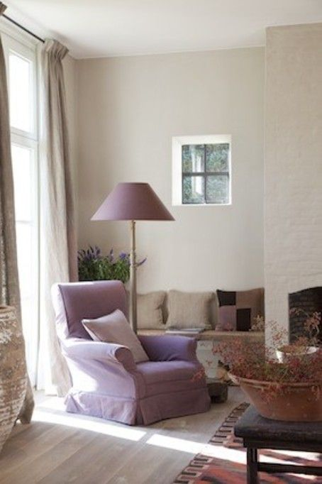 A little too much tan/brown, but I love the purple chair, lamp, and it looks like drapes with a pattern on it.