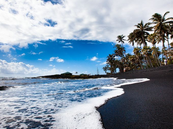 Hawaii's volcanic geology means that many of the island's beaches are covered in black sand. Punaluu Black Sand Beach on Hawaii's Big Island