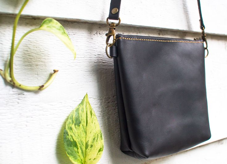 Leather cross body bag. Add a attachable hand strap to turn this purse into a clutch. Available on ETSY.