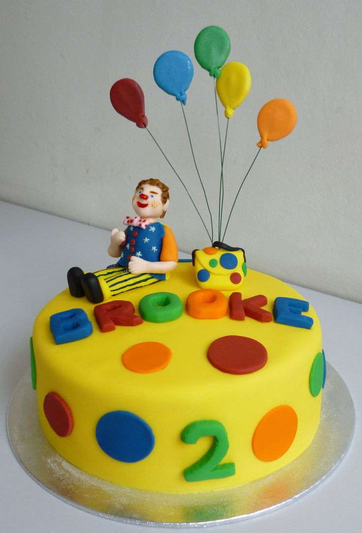 Mr Tumble cake for Brooke - Vanilla sponge with raspberry jam and vanilla buttercream filling  Decorated with fondant icing and gumpaste