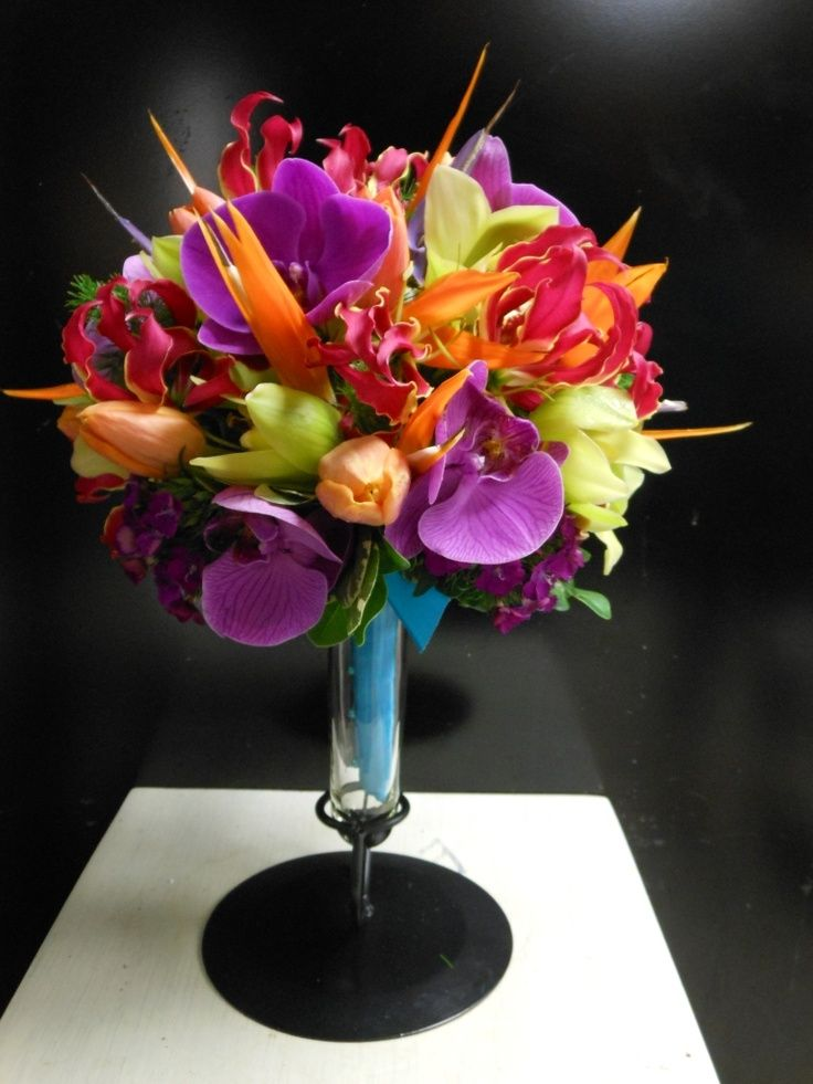 Super colorful, modern wedding bouquet. Love the use of non-traditional bouquet flowers, like the Birds Of Paradise.