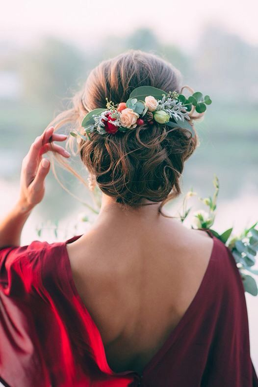 Wedding updo with flowers and leaves. Gorgeous deep reds.