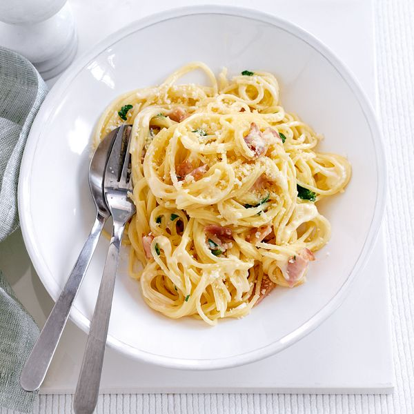 This spaghetti carbonara recipe has half the fat and 125 fewer calories compared to a traditional carbonara.