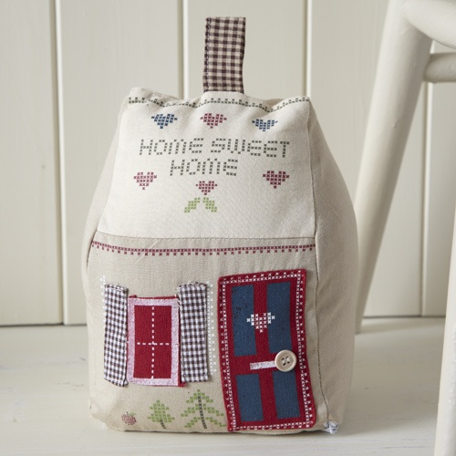 "Country style door stop with ""home sweet home"" stitched on the front with wooden button and fabric patchwork detail.  Removable cover.  H21cm  W17cm D14cm.  £12.95"