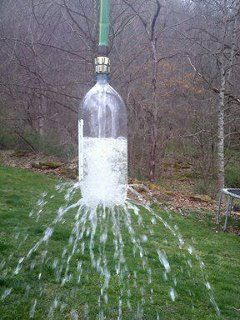 Take a 2 liter soda bottle, poke holes in it. Attach to a garden hose. Toss over a tree branch and let it hang for a kids water sprinkler.