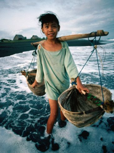 A Girl Gathers Salt Water in Lontar Leaf Buckets for Salt Making, Kusamba, Indonesia Photographic Print by Adams Gregory at AllPosters.com
