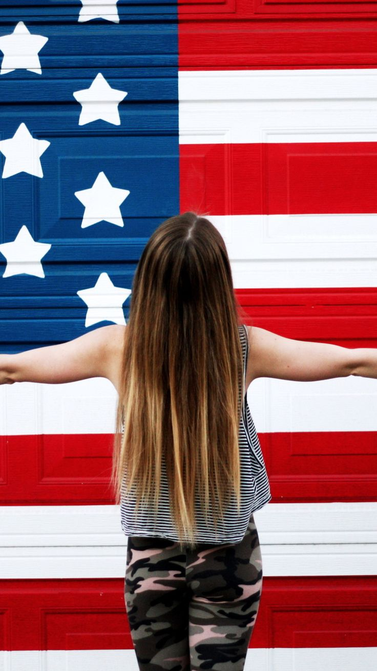 American Girl In Front Of USA Flag.