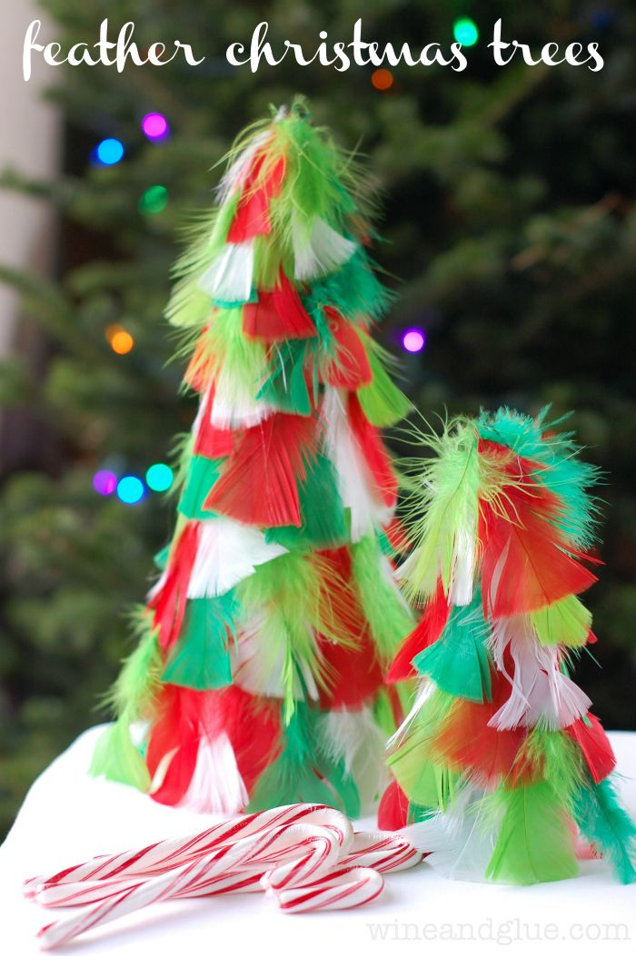 Feather Christmas TreesThese simple and easy Christmas trees come together in a snap and are a super fun way to decorate!
