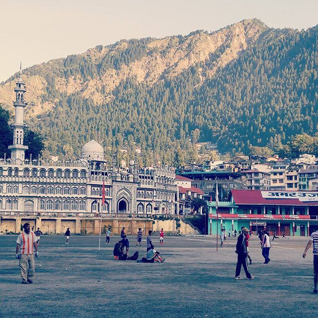 6:30 am soccer at #nainitalflats. The Islamic center stands to the left with beautiful calls to prayer and the majestic mountains of #Nainital hold it all in. #travel #Uttarakhand #India #soccer #futbol #Islam #mountains #sunrise #morning #prayer