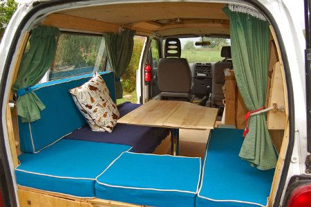 Inside the conversion - seating and table Another view inside David's DIY Toyota Hiace camper conversion