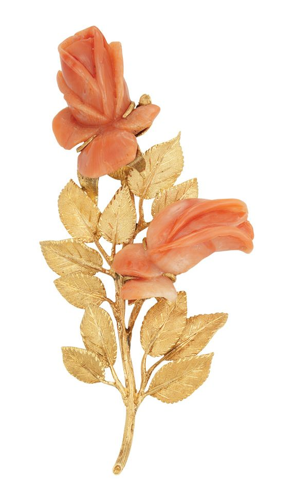 Gold and Carved Coral Flower Clip-Brooch, Mario Buccellati   18 kt., the textured gold stem supporting textured gold leaves, embellished by 2 carved coral flowers, signed M. Buccellati, Italy, approximately 20.8 dwt