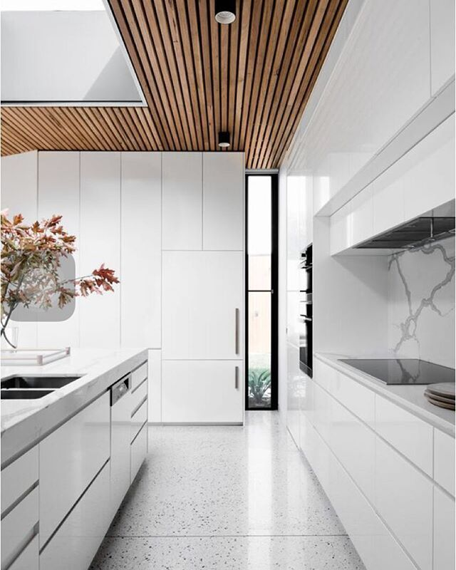 Inside the kitchen at our courtyard house project. The white interior is…