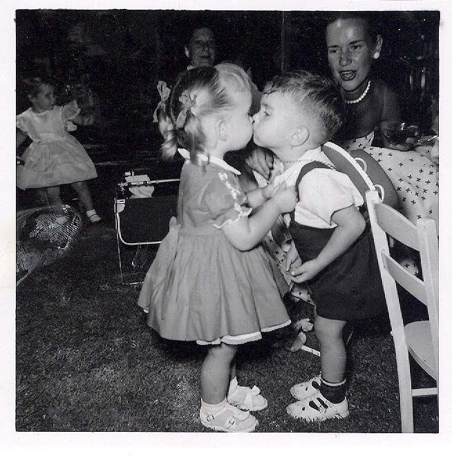 Vintage photo ~ Two little kids at a party, kissing each other.