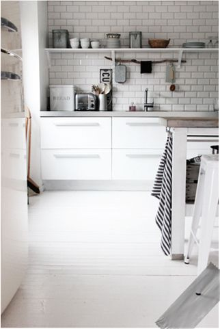 Either subway tiles  (would an accent strip of different color blue glass tile work), or white quartz in subway pattern