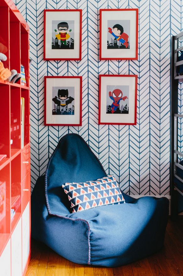 """We can't stop """"marvel-ing"""" at this adorable """"heroes"""" corner! W/ bold wallpaper, cute graphic art, & a comfy place to sit, this reading corner is perf for any """"hero-to-be."""""""