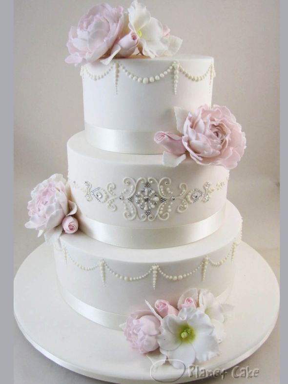 Like the pearls on the cake. Perhaps replace the flowers with strawberries?