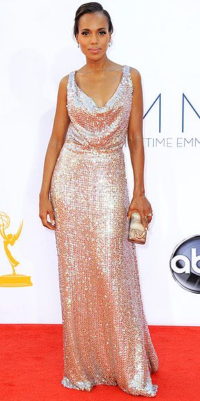 KERRY WASHINGTON  The Scandal star says she kept her Fred Leighton jewelry simple because her fully sequined Vivienne Westwood rose-gold gown sparkles enough on its own. She wears Christian Louboutin heels and carries a Kotur clutch embellished with a lizard.