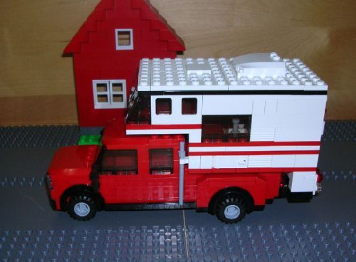 Red Pickup truck with slide in camper made with LEGO
