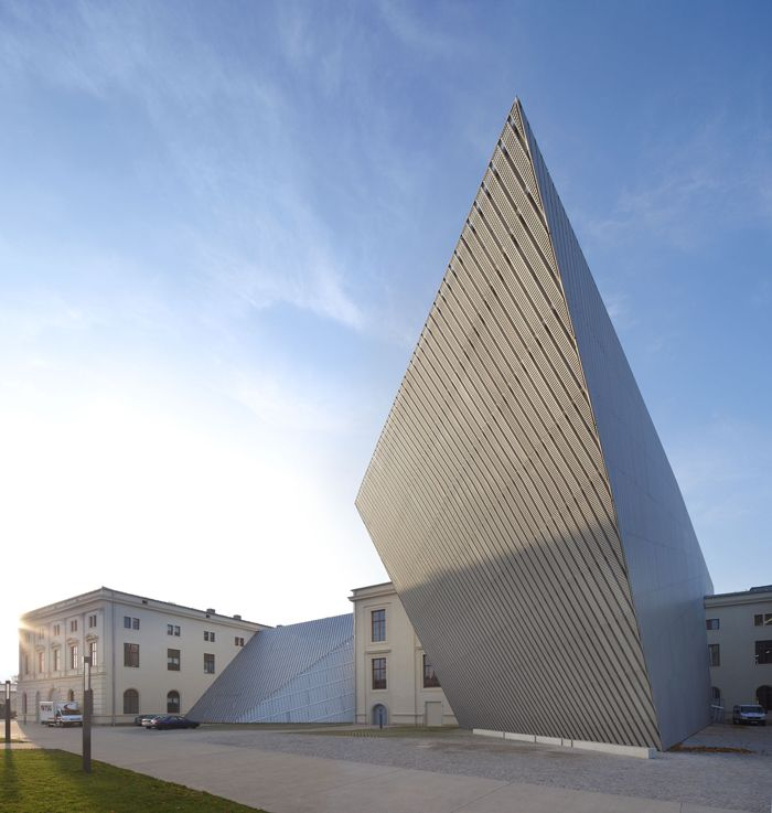 Now the official museum of the German Armed Forces, the Dresden Museum of Military History was once shut down by a German government uncertain of how the institution would fit into a newly unified German state. Studio Libeskind was selected as design architect for an extension in 2001, when an architectural competition was held. The winning design boldly interrupts the original building's classical symmetry. The extension, a massive, five-story 14,500-ton wedge of glass, concrete, and…