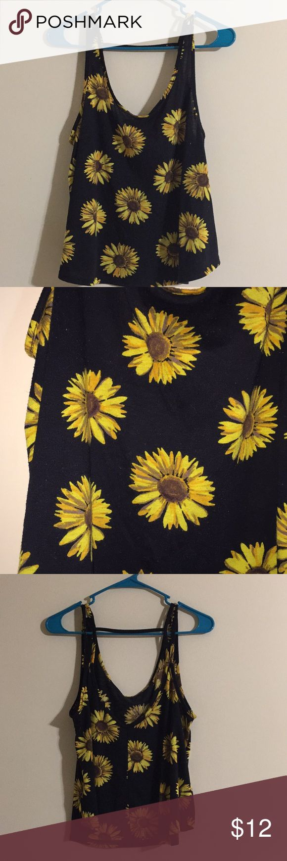 Sunflower Tank Top This Forever 21 tank top has a sunflower design and is perfect for a casual day or a night out! Worn only a few times. Forever 21 Tops Tank Tops