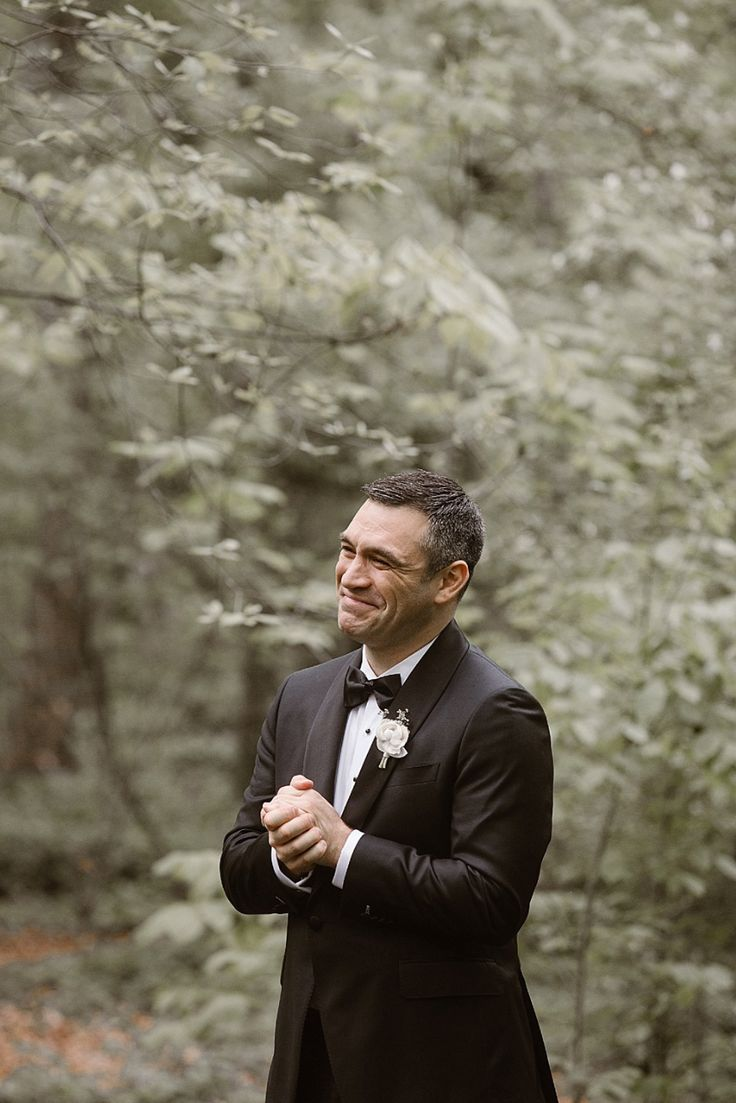 Emotional groom's first look photo.