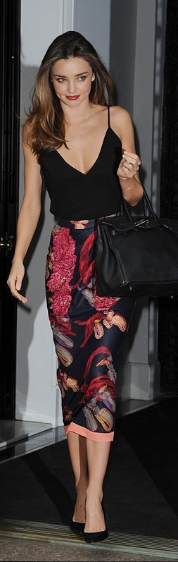 Who made  Miranda Kerr's pink floral print skirt and black leather handbag that she wore in New York