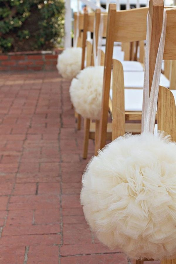 Should I have them as decoration for the ceremony or hold one down the aisle?