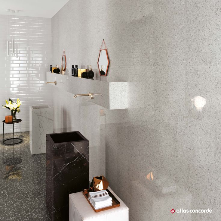 Eramic tiles evoking venetian terrazzo create wellness areas where contemporary design meets italian tradition