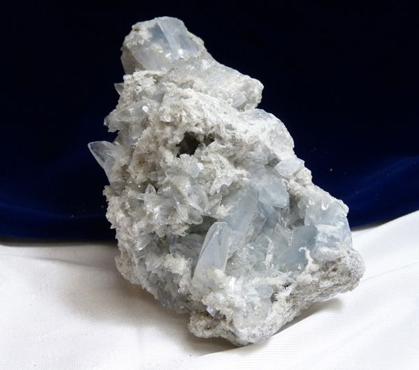 Madagascar Celestite Loose Stone  Madagascar's Blue-gray Celestite comes primarily in clusters. Celestite offers a gentle, uplifting energy which can raise and expand one's awareness and is excellent for your emotional state as it is calming and aids mental clarity as it clears and sharpens mental faculties.  Weight: 1850 grams Length: 7 1/2 in Height: 4 3/4 in Width: 4 in