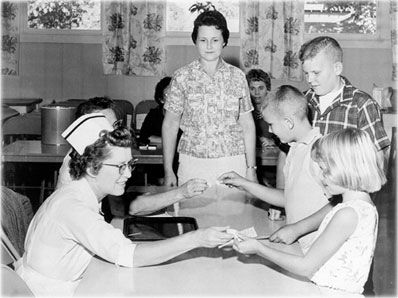Oral polio vaccine on sugar cubes. My mother had polio and was one of the lucky ones to recover. She made sure we were some of the first in line when the vaccine came out. I can still remember my older brother walking me to the neighborhood high school to get ours.