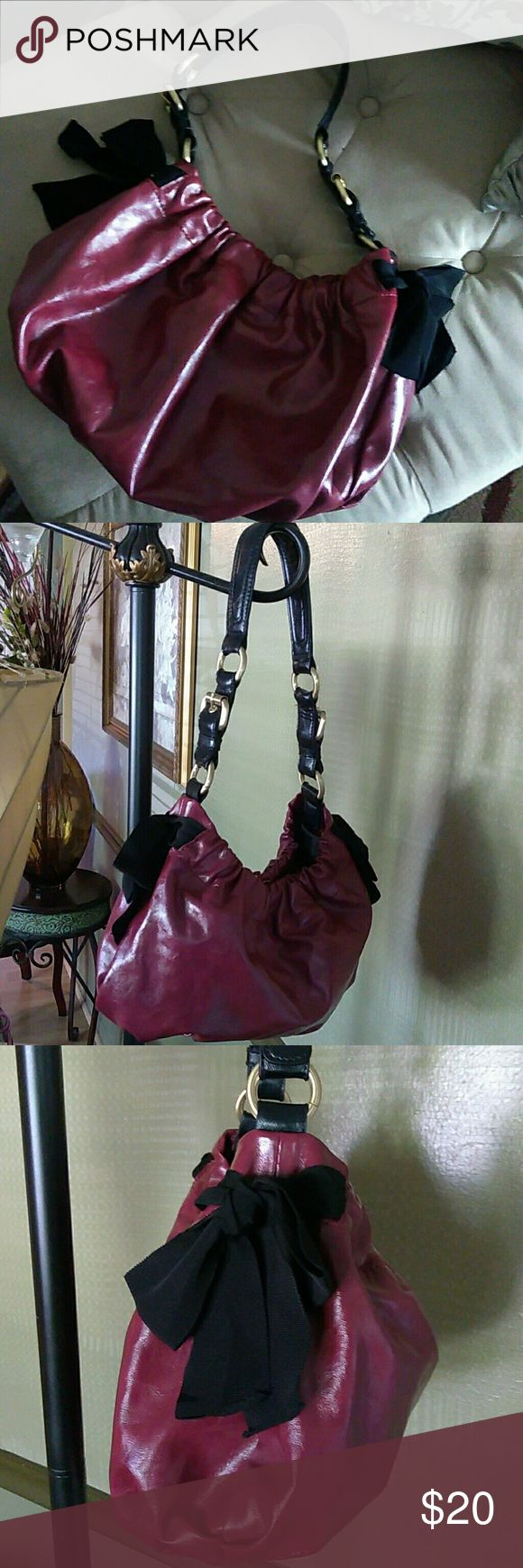 """Simply Vera Wang Hobo Cute and feminine bag with chiffon-type side bows and gathered opening. Leather strap; PU bag. Snap magnetic closure. Measures 13"""" X 9.5. Gold hardware. Maroon/Burgundy color. Simply Vera Vera Wang Bags Hobos"""