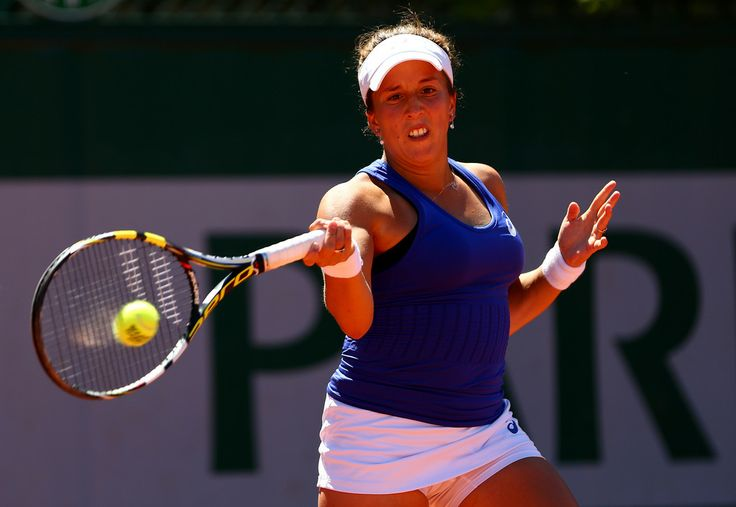 Irina Falconi of the United States returns a shot during her women's singles qualifying match afainst Heather Watson of Great Britain during previews ahead of the French Open at Roland Garros on May 22, 2014 in Paris, France.